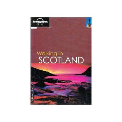 Walking in Scotland ( Editura: Lonely Planet, Autor: Sandra Bardwell, Nancy Frey ISBN 1-86450-350-5 )